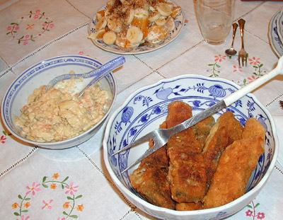 Fried carp and cold potato salad.